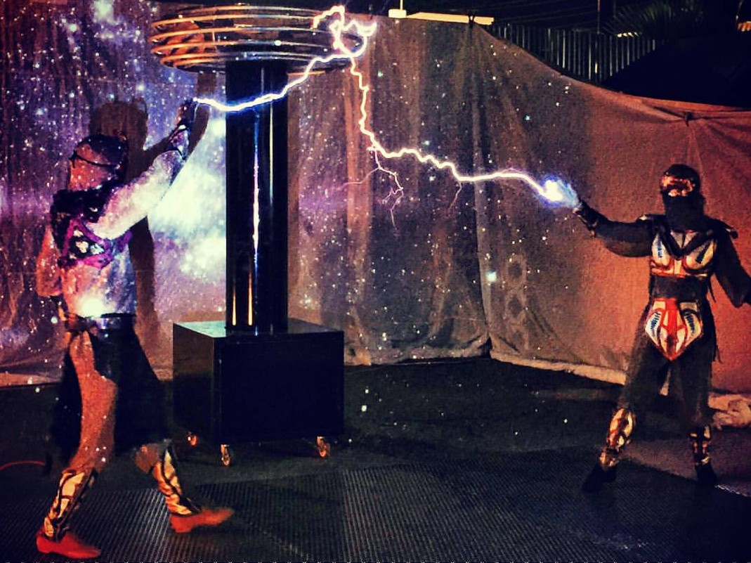 Lester and Samantha performing with Skyfire Arts tesla coil creating a rare occurrence where the arc splits and makes connection with 2 grounding points at the same time. It just so happens to create the perfect little heart too :)