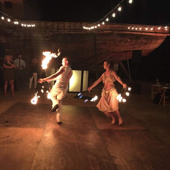performing their fire dance duet for a private wedding in wine country Mexico wedding entertainment fire show